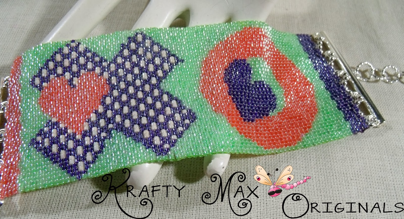 http://www.lajuliet.com/index.php/2013-01-04-15-21-51/ad/beaded,49/exclusive-x-s-and-o-s-are-hugs-and-kisses-for-everyone-handmade-beadwoven-bracelet-by-krafty-max-originals,305