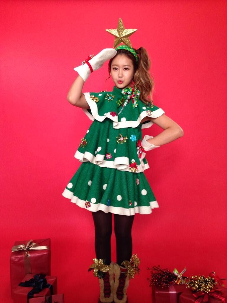 Christmas concept donning christmas tree like dresses complete with a