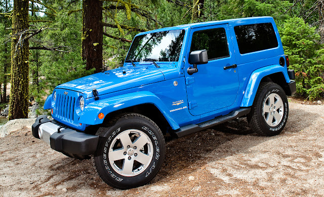 Front 3/4 view of blue 2012 Jeep Wrangler in mountains