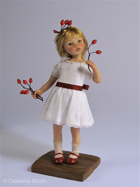 art doll little girl with red berries