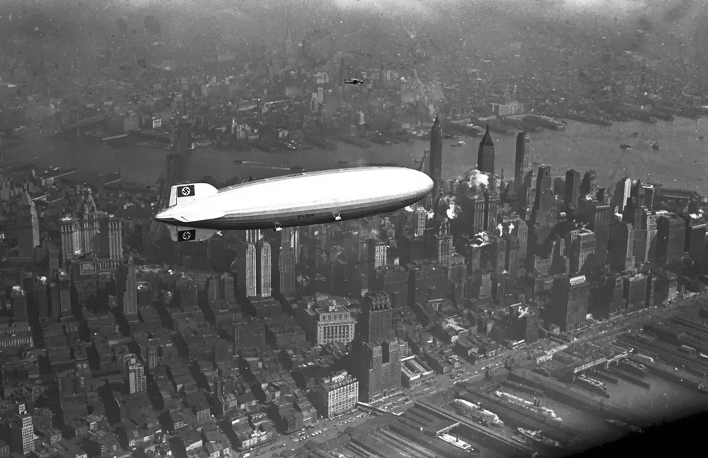 The German zeppelin Hindenburg flies over Manhattan on May 6, 1937. A few hours later, the ship burst into flames.