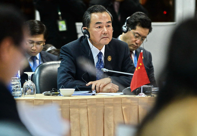 Wang Yi, China's foreign minister, center, listens during a ASEAN-China Ministerial Meeting in Brunei's capital Bandar Seri Begawan on June 30, 2013.