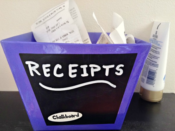 Creating a system to organize receipts by the front door will help you organize them for budgeting and money saving. What a simple solution. | Managing a Home