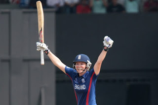 Charlotte-Edwards-captain-of-England-raises-her-bat-after-scoring-a-century