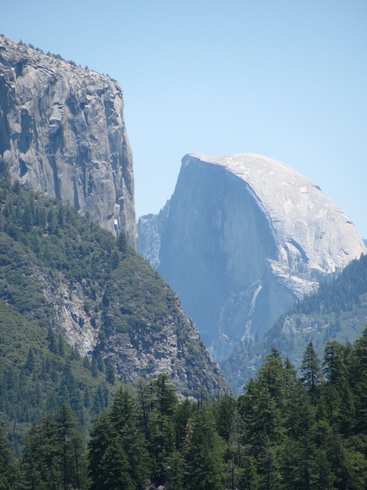 Granite half dome towers above the valley floor at Yosemite National Park, California