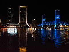 JAX Landing at night from across the St. John's River. Hyatt is to the right of the bridge.