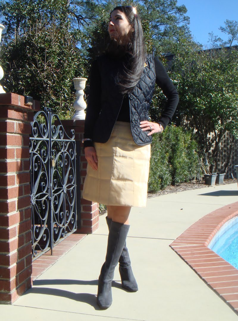 Quilted vest and quilted skirt outfit with head looking up and wind blowing in hair.
