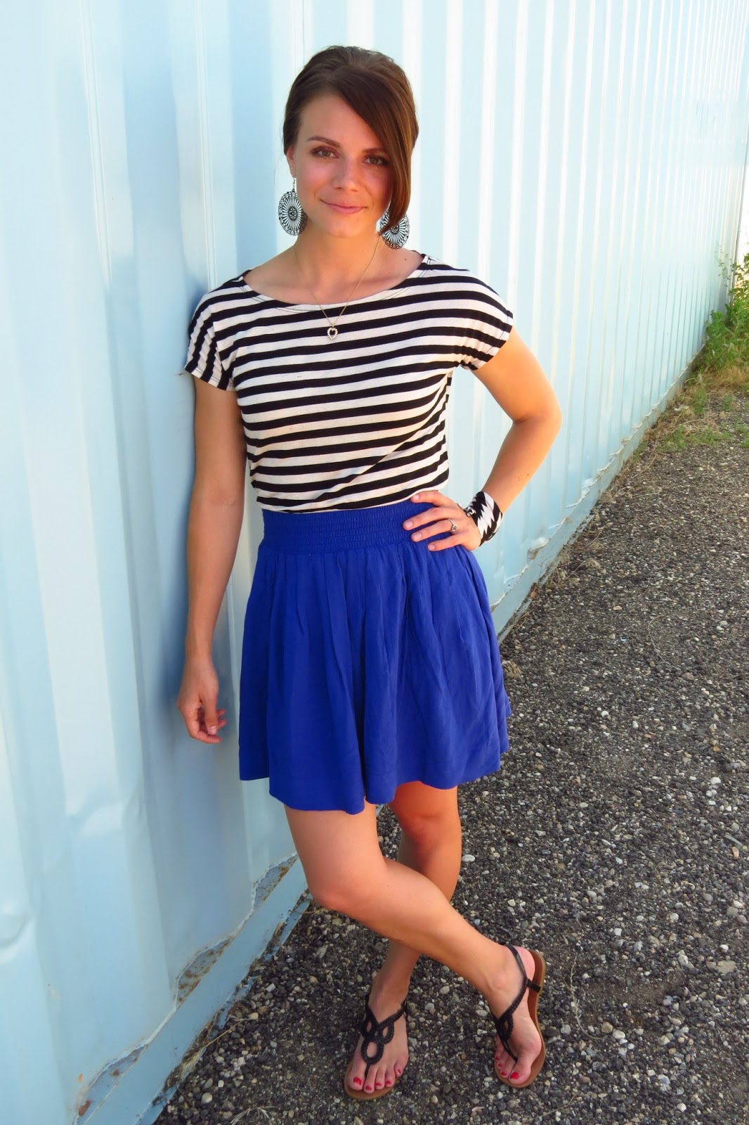 striped top and high-waisted skirt