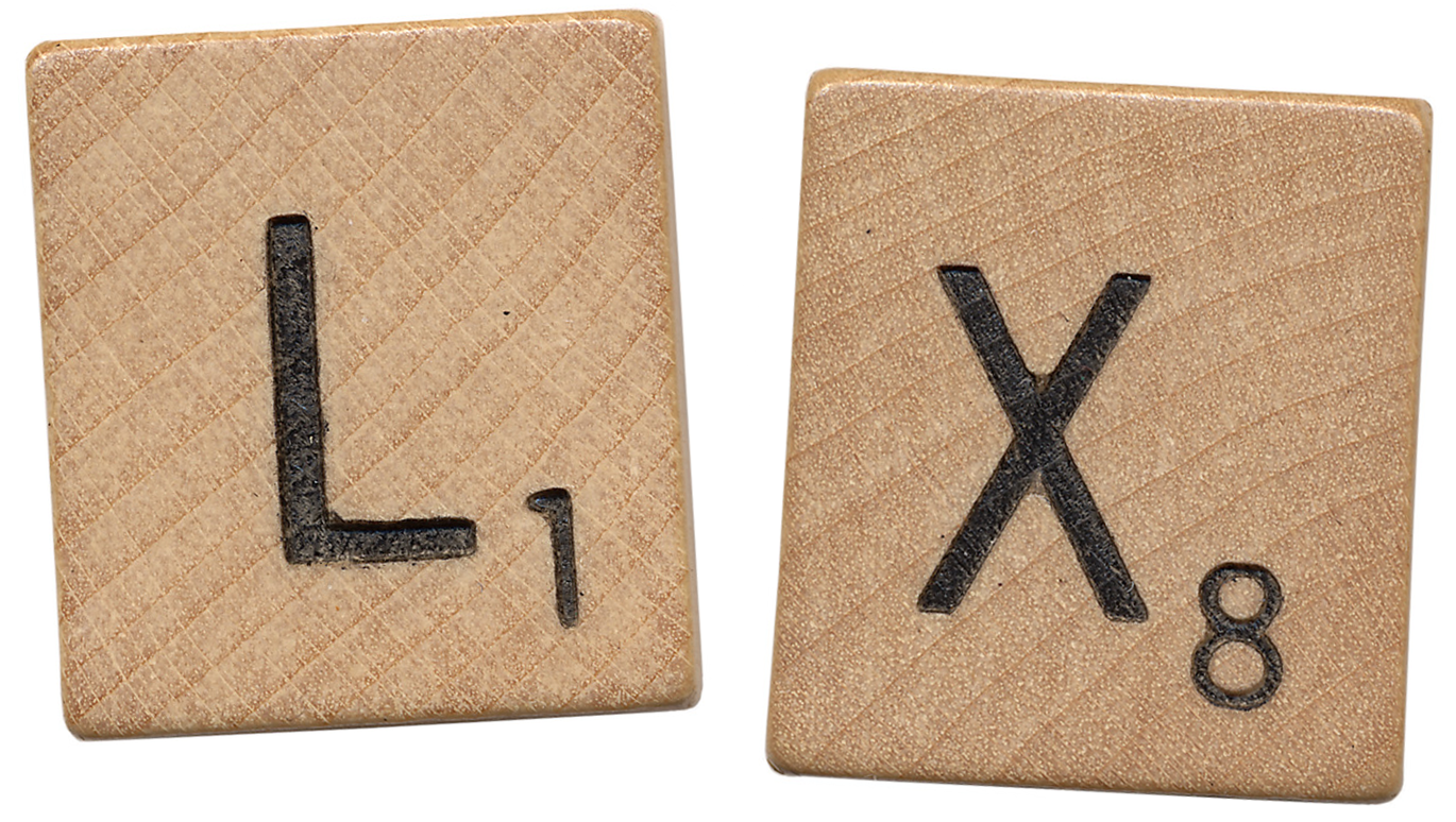 The letters L and X in Scrabble tiles