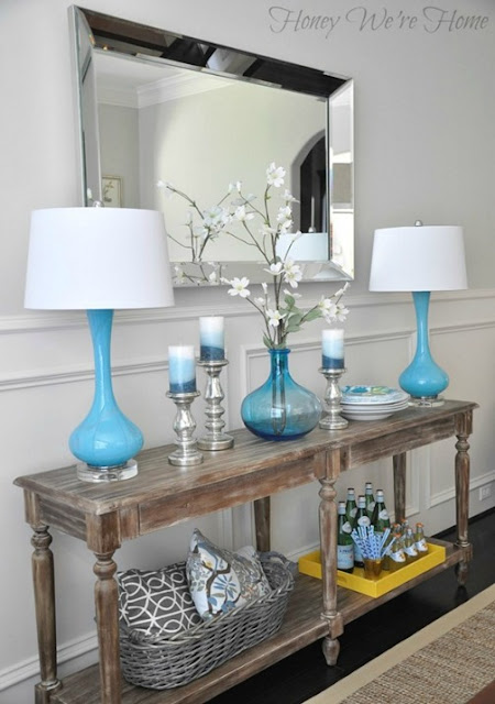 console table vignette blue lamps
