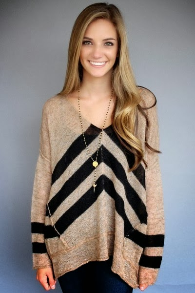 Adorable light brown sweater with black linings
