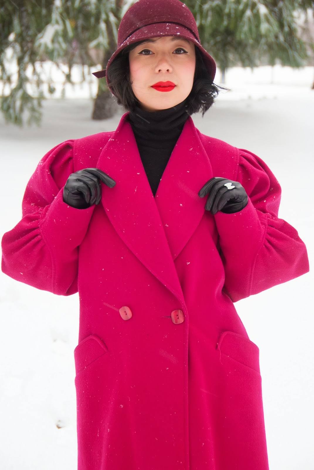 fushia coat red lips black turtleneck maroon cloche leather gloves boots michael kors bromley wool skirt snow winter fashion