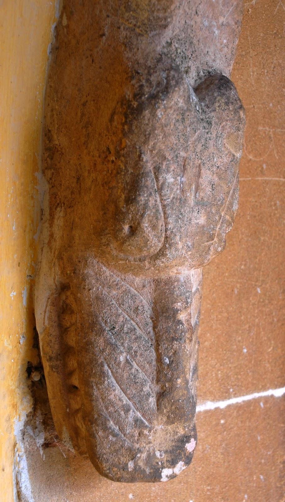 Norman / Romanesque dragon doorstop at Hankerton church, Wiltshire