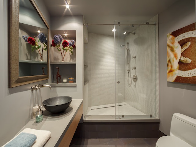 Picture of contemporary bathroom interiors with corner shower cabin and modern sink