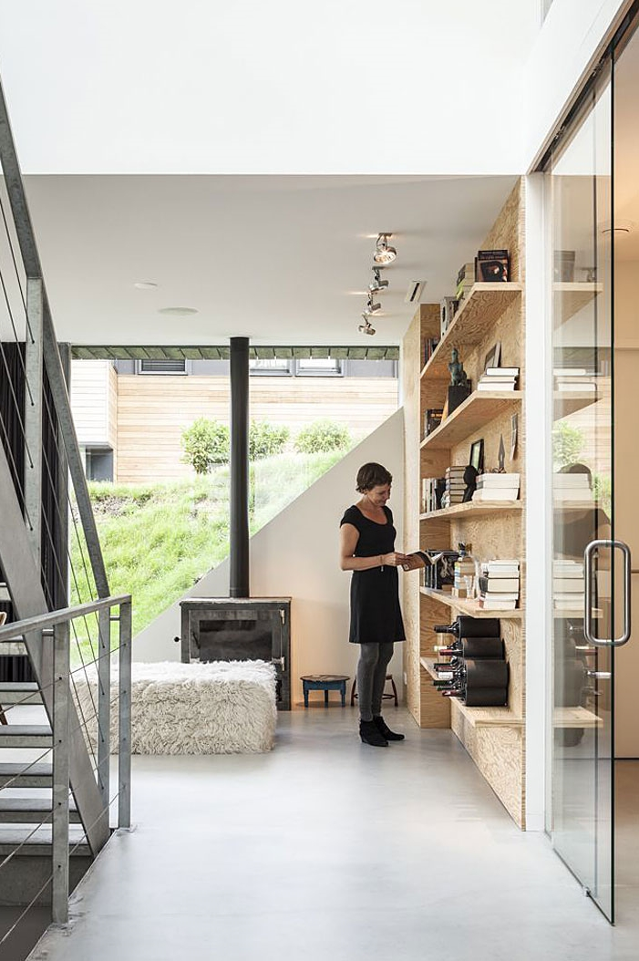 Wooden book shelves in Modern Villa V by Paul de Ruiter Architects