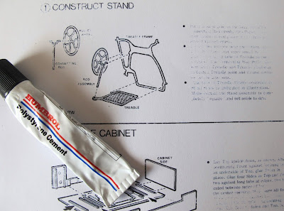Instructions for a dolls' house miniature treadle sewing machine, with a tube of glue.