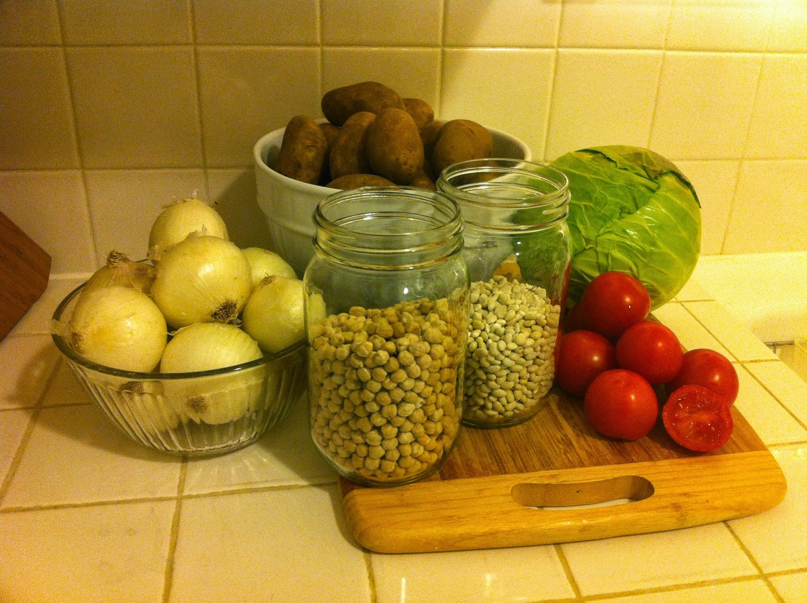 Image of potatoes, cabbage, beans, tomatoes, and onions that will be eaten over 5 days.