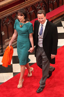 British Prime Minister David Cameron (r.) and wife Samantha Cameron arrive at Westminster Abbey.