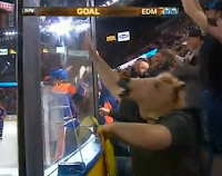 Man with horse mask celebrates Ales Hemsky goal
