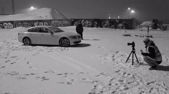 taking pictures of a car in the snow