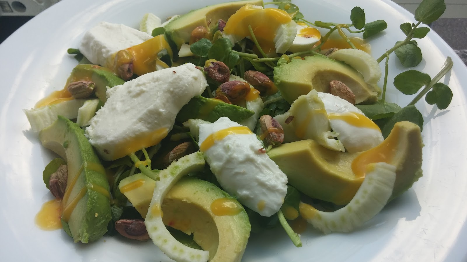 Fennel, mozzarella & avocado salad with chilli mango dressing and pistachio nuts.