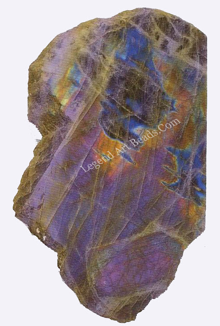 LABRADORITE The feldspar mineral labradorite can occur as yellowish crystals but more often it forms dull grey crystalline masses. Internal twinning causes interference of light which gives the mineral a sheen, or Schiller, with patches of different colours.