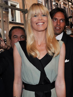 Claudia Schiffer Full Bangs and Straight Layered Hairstyle