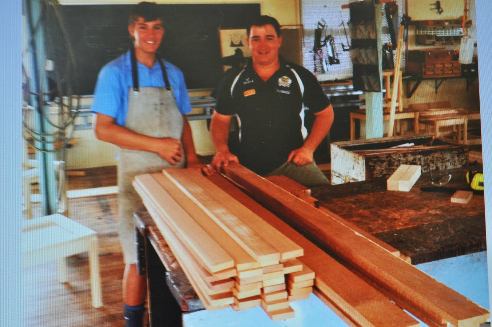 Tom McQueen and Max Batt admire the silky oak timber donated by past student Patrick Kenna