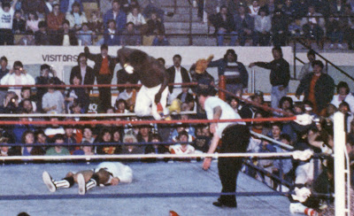 Koko B Ware drops a fist on Danny Davis as Terry Yorkston lays the count at a WWF show in Newmarket, Ontario on March 17, 1987.