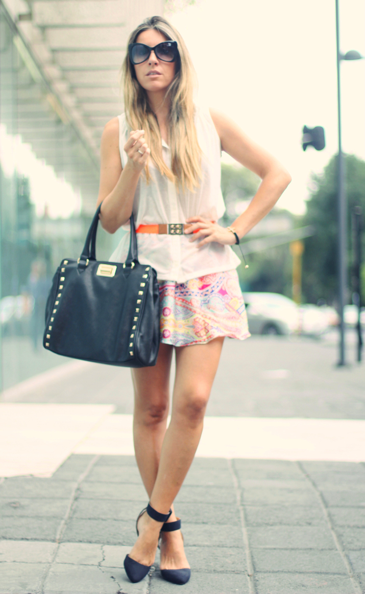 Fashion blogger wearing scarf skirt and studded bag
