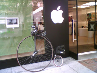 penny-farthing bicycle in front of apple store. funny hipster fail