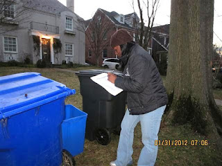 Ms. Fountain taking notes about her container observations for our recycling survey