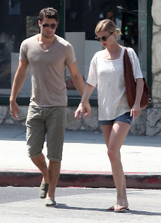 Emily VanCamp and Josh Bowman holding hands