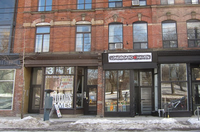 Photo: exterior of Longboard Haven skate shop at 183 Queen St. E