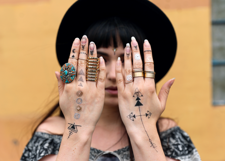 hippy, hippie, tattoos, tattooed hands, bohemian rings, wide brim fedora