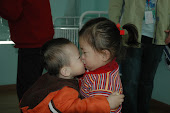 Naomi kissing Miles - Dec 2010