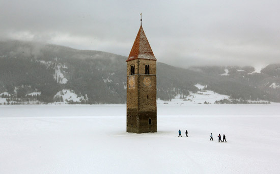 Drowned Church of Lake Reschen in Italy during winter