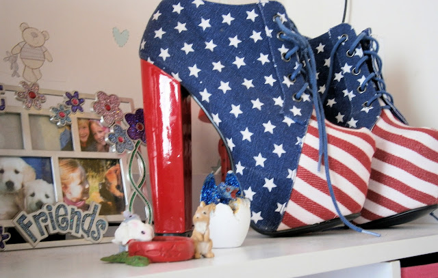 very high heeled boots red white blue