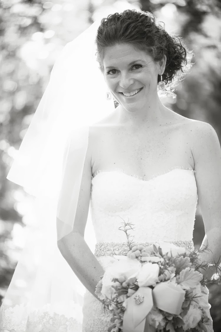 bride in her Monique Lhuillier wedding dress with her bouquet of flowers