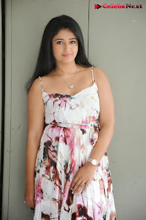 Actress Poonam Bajwa Pictures in Floral Dress at Gulf Andhra Music Awards 2013 Press Meet  0036.jpg