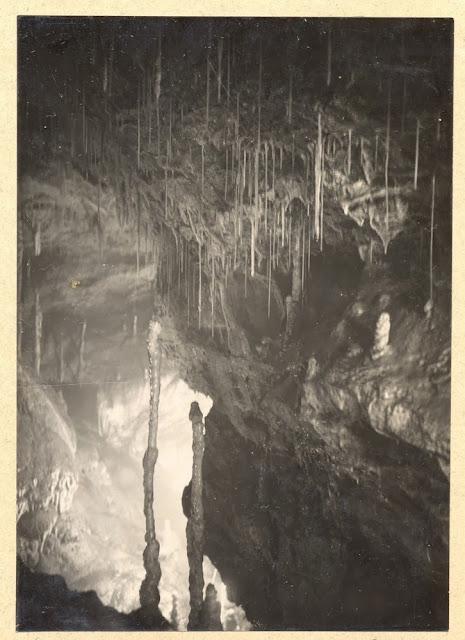 Slender stalagmite pillars. Swildon's Hole, cave near Priddy, Mendips, Somerset.1921.