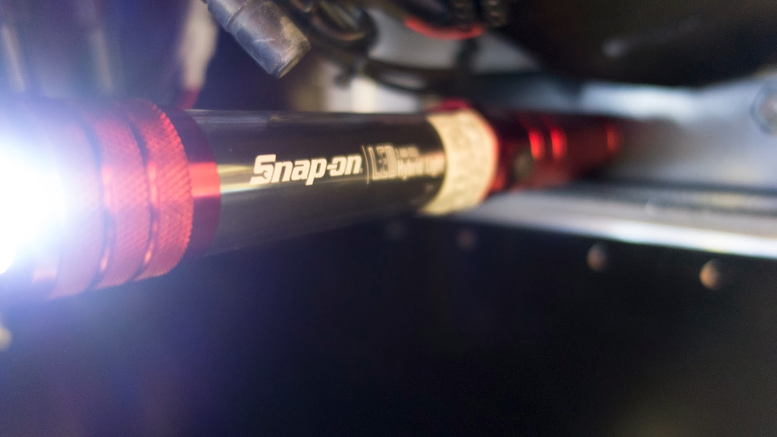 A Snap-on LED light and torch that I got from my mate Lee for my birthday.  It was a cool gift, until today when it became an UBER cool gift as it has a magnet in the base so sticks to the chassis perfectly - no need for another pair of hands!