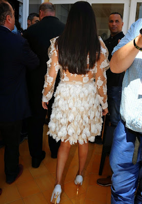 Selena Gomez flashes white bra in a sheer dress at a press conference in Ischia