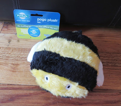 Our dogs really like the PetSafe Pogo Plush bee toy.  It squeeks but has no stuffing so there's no mess!