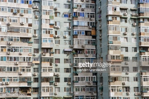 China Beijing Apartment Building Facade with Air Conditioners (Credit: Getty Images) Click to Enlarge.