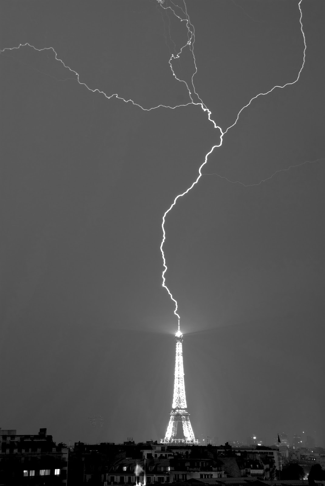 Lightning strike on Eiffel Tower black and white Photo