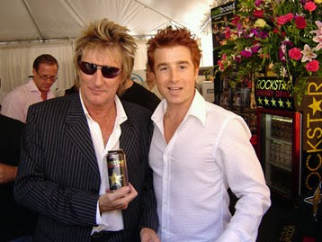 Rod Stewart wearing sunglasses inside holding Rockstar energy drink