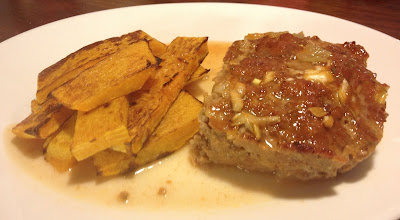 portion of sriracha meatloaf with butternut squash fries