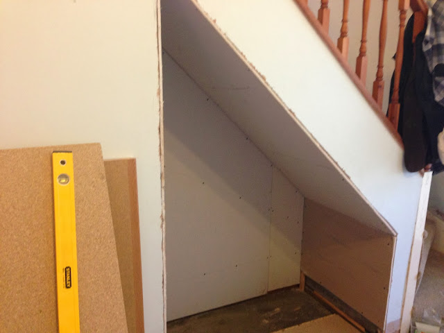 work in progress cat feeding solution under stairs