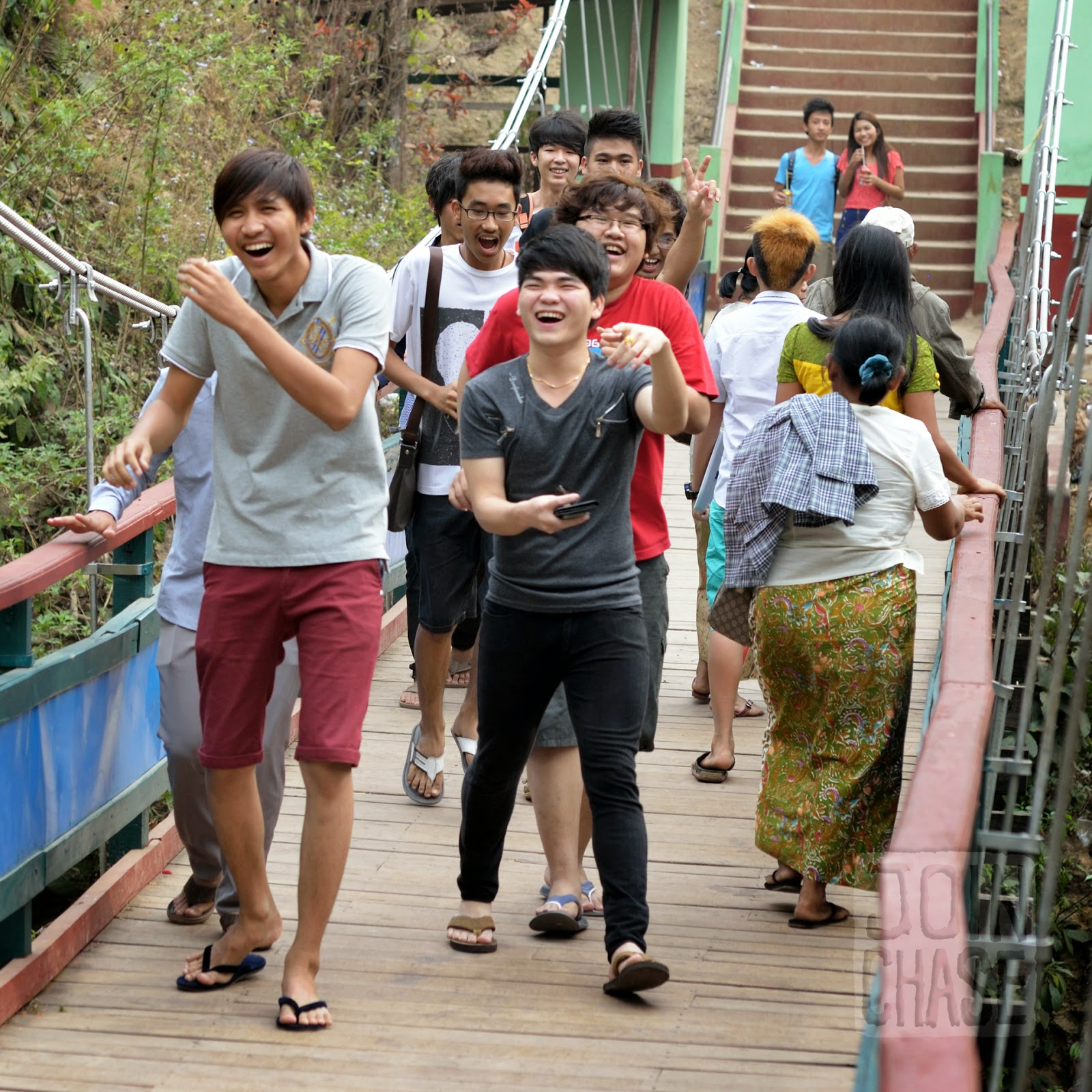 A group of people crossing the bridge near Peik Chin Myaung, Pyin Oo Lwin, Myanmar.